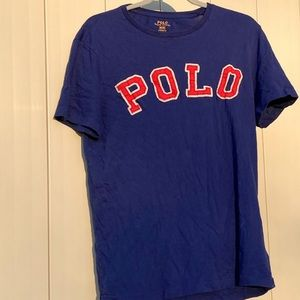 Royal blue polo shirt with red logo stitched on